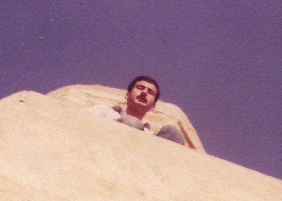 Walid Abdel Hamid, a local resident of 'Anah standing on the minaret.